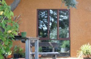 The majority of the straw bale home's timber frame, including the jarrah windows, are recycled wood.