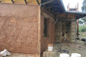 Three coats of successively finer clay were used to render the straw bale house.