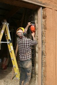 Shaping straw bales house walls with a chainsaw is standard practice but Joel Meadows found exhaust fumes are noxious.